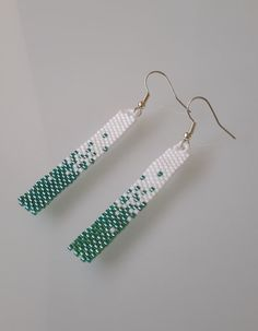 Peyote tapestry has been used to create these pretty earrings, made with Shiny Green and Matt White delica beads, which give a shimmering effect when worn. These measure just over 2 inches in length from the earring hook. Please remember free shipping in the UK, Wahooo