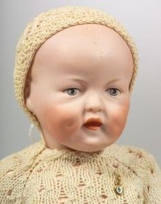 German bisque character baby by Catterfelder Puppenfabrik, marked C.P. 201 28, with painted eyes and open-closed mouth, early 20th century.