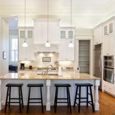 Make a bright statement by pairing crisp white paint with ebony and stainless steel. The result is a modern, but classic, kitchen.