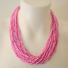 Beautiful and Elegant, lovely light pink necklace features multiple strands of tiny glass beads that loop together to form a full cluster beaded necklace.  - $15.99