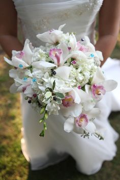 Hydrangea and lily bridal bouquet with bouquet jewelry