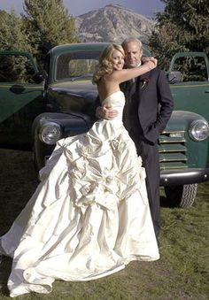 9/25/2004: Kevin Costner & Christine Baumgartner, a country wedding with the groom rowing a canoe with his bride in tow...so to speak after the I Do's...