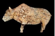 A sculpture of a female bison, found at Zaraysk, Russia; about 20,000 years old.