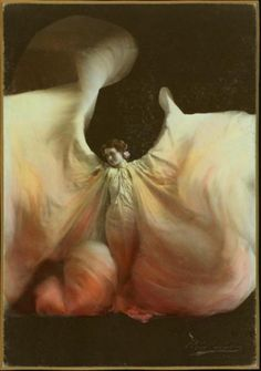 Loïe Fuller imitator, photograph by Marceau. Credited between 1890 and 1909