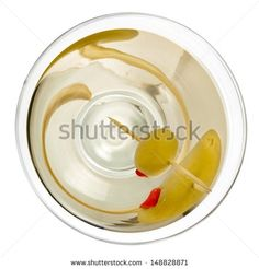 Cocktail with a green olive, top view - Shutterstock Premier