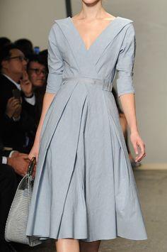 Blue linen blend dress with self belt, 3/4 sleeves, and deep v-neck by Donna Karan