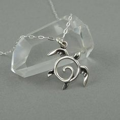 Sweet and simple! Sterling silver Honu Turtle tiny charm necklace. The Turtle charm is .55 tall and has a thin profile. All jewelry parts are 925 solid sterling silver. These make perfect gifts for little girls or just buy a charm for your charm bracelet!  Available in 16 (model shown), 18 #SimpleSterlingSilver