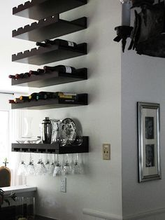 After: Bar Wall Storage After: Bar Wall Storage With repainted lower cabinets, the bar area was well on its way to looking better. Lauren fastened wine racks to the wall for a space-savvy way to store wine and crystal glasses. Everything for serving drinks is at Lauren's fingertips when she entertains; she often uses the countertop and ledge above as a buffet.