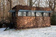 A Mobile Log Cabin _ Don't like the view?  Move… this amazing log studio is on wheels!  Further proof of the beauty of small buildings.  Designed by Dutch designer, Piet Hein Eek, this music room/studio is built on a wheeled chassis for easy transportation.  Look closely and you'll notice that the bottom logs are loose infills.What are your thoughts?