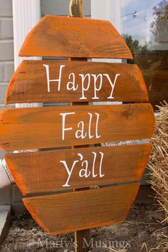 Greet everyone a happy fall with this easy pallet sign. Just shape it like a pumpkin and add some paint.