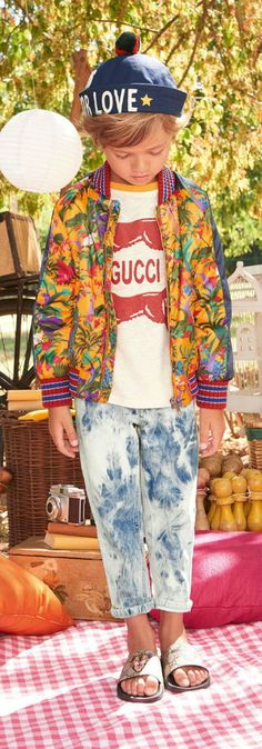 GUCCI Boys Floral Print Bomber Jacket, White & Red Logo Shirt & Acid Wash Jeans for Spring Summer 2018. Super Cool GUCCI Tiger Logo Flip Flops and Blue Love sailor hat.