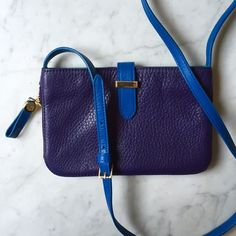 ✨Sale!✨Tory Burch Color Block Crossbody Bag Perfect touch of color to your outfit! Beautiful leather crossbody bag from Tory Burch, new with tags, never worn! Purple leather exterior with cobalt blue strap, gold hardware and emerald green wallet interior. Zipper detail opens to make more room and reveals emerald green leather. Beautiful bag!  BUNDLE & SAVE  Tory Burch Bags Crossbody Bags