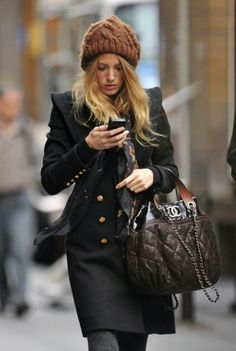 I wonder if she is reading a text from Ryan Reynolds:O