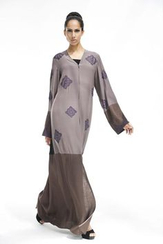 Arabesque signature classic cut abaya, mix and match of fabrics, silk and linen embellished with multiple hand embroidery motifs.