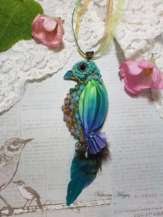 Check out this item in my Etsy shop https://www.etsy.com/listing/486314541/brooch-pendant-paradise-bird-brooch-with