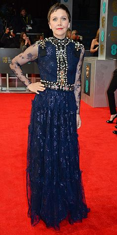 BAFTA Fashion: See What the Stars Wore | MAGGIE GYLLENHAAL | Is it just us or does this lace navy Lanvin with mock turtleneck, sheer sleeves, crystal-adorned epaulettes and enormous pearl accoutrements look made for Lady Grantham?