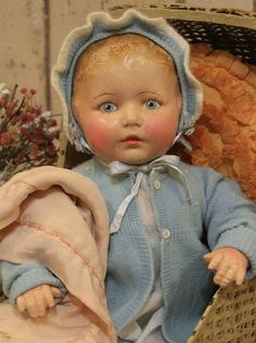 Sweet old antique baby doll in vintage clothing.Beautiful blue eyes and blonde hair ~ I sold a vinyl doll that looked like this & had a sweater & bonnet just like this. Much smaller. Pretty Dolls, Beautiful Dolls, Doll Toys, Baby Dolls, Vintage Dolls, Vintage Clothing, Dream Doll, Reborn, Old Dolls