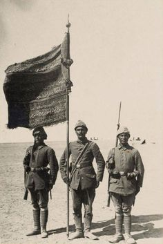 Ottoman soldiers with a regimental standard awarded for their service in the First Battle of Gaza where they defeated the British 1917.
