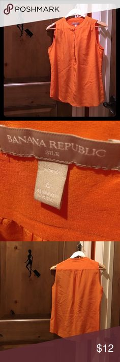 Banana Republic 100% silk sleeveless top Banana Republic orange sleeveless top.  Size 6 petite.  It has 4 snap buttons in the front.  Gently used.  Has a very tiny black mark near the hem.  See pic 4.  No trade.  Non-smoking and pet free home. Banana Republic Tops