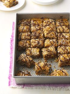 Recipe by Cheryl Andrews Coconut-caramel Samoas are ideal for this chocolate-drizzled riff on baklava, layered with walnuts, coconut flakes, honey, and that addictive, flakey phyllo dough.   - Delish.com