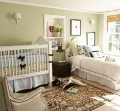 This is my all time favorite nursery for two kids of different ages.  If I were you, I'd try to set the far wall in the room up like this.  You could substitute the bed for the crib, and the crib for the pack and play for now.  Then, put one piece of furniture between them, and the rest on the other wall.  Isn't it cute?