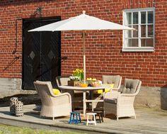 puutarhapöytä,tiikkipöytä,polyrottinki,aurinkovarjo,isku