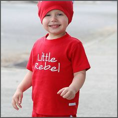 Red 'Little Rebel' Tee. Let your little rebel show off his independence in this fun tee. We promise the softness and quality will amaze you! Made to match perfectly with our 'Red Skull Crawler' and 'Red Skull Stretch Beanie,' this set is sure to be one of his favourites!
