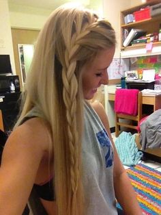 Front side french braid with hair down. Nice twist on the norm.