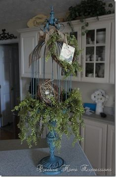 Birdcage on a Pedestal! Paint teal, add moss & burlap!! Done deal.
