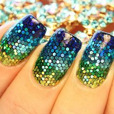 These sparkling nails were made by carefully placing individual pieces of glitter — yes, really.