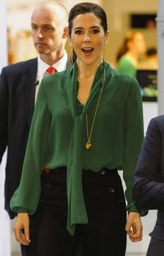 Crown Princess Mary of Denmark in a By Malene Birger Peacock Green Tie Neck Top with Ole Lynggaard Copenhagen jewelry.