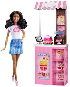 """Explore the sweet fun of owning a bakery with this Barbie bakery owner play set. Young bakers can play out cake-making for """"customers"""" with a cake accessory that features multiple stacking layers ..."""
