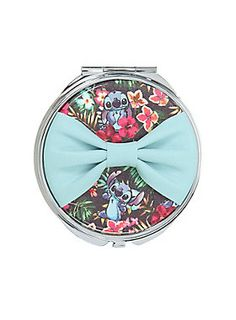 "<p>Silver tone metal hinged mirror from Disney's Lilo & Stitch with a faux leather bow & floral Stitch design.</p>  <ul> 	<li>2 3/4"" wide</li> 	<li>Metal</li> 	<li>Imported</li> </ul>"