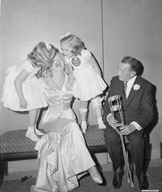 Fred Morgan - Marilyn Monroe - January 28 1958 - with March of Dimes poster children, Linda Lou and Sandy Sue, and Basil O'Connor of the Polio Foundation at the 14th Annual March of Dimes Fashion Show at the Waldorf AstoriaFred Morgan