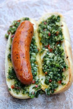 Choripan is a traditional Argentinean street food or BBQ style sandwich consisting of grilled chorizo on bread topped with chimichurri sauce. I Love Food, Good Food, Yummy Food, Healthy Food, Dog Recipes, Cooking Recipes, Argentina Food, Food For Thought, Snacks