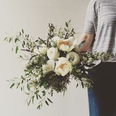 Natural bouquet of tree peonies, spirea, and lavender