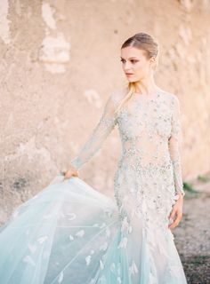 For the fashion forward bride, think outside the box and add a touch of serenity to your wedding gown for a dramatic wedding day look.