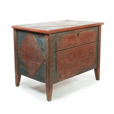 "Garths | Lot 432 CONTINENTAL STORAGE CHEST.  Nineteenth century. Remnants of blue and red paint. Diamond panel top and sides and a cut cornered panel on the face. Molded legs. Pinned construction. 34.5""h. 44""w. 18""d.  Estimate $ 150-300"