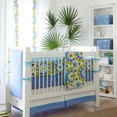 Green, white, and turquoise nursery