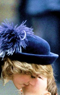 A young Prince Harry whispering in his mum's ear, Princess Diana