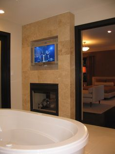 OMG I always dream of having a see thru fireplace and TV at the end of my whirlpool tub!