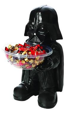 """Star Wars Darth Vader Candy Bowl. Give your kitchen some Star Wars flair with the Star Wars Darth Vader Candy Bowl Holder! Featuring Darth Vader from Star Wars in his instantly recognizable costume. Whether you're using this detailed guy as a decorative kitchen piece or as functional Halloween decor, you're going to love the Star Wars Darth Vader candy bowl holder! Holder. Size: 16"""" x 12"""" x 10"""" Price: $32.99"""