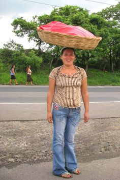 """Look. Words appear on the walls:   """"Hoy, defendemos el voto   Mañana el poder popular.""""   Women carrying baskets of fruit on their heads   Will teach us how to walk."""