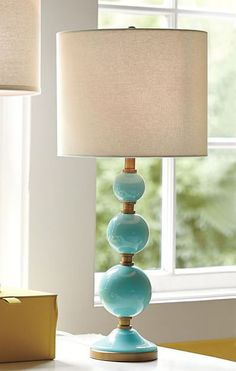 Stacked bubbles make thisTilda Bubble Table Lamp a playful accent on a bedside table or dresser. Expertly crafted of hand-blown glass. $149. Buy here.