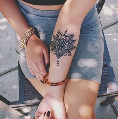 forearm tattoo lotus mandala