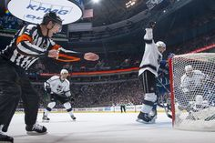 Referee Wes McCauley signals a goal by Dustin Brown of the LA Kings during Game 2 of the Western Conference Quarterfinals. Western Conference, Referee, Nhl, Hockey, Westerns, Basketball Court, Game, Brown, Fitness