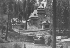 """Photograph taken from a 1906 issue of American Homes and Gardens in an article titled """"'Myntoon', a Mediaeval Castle in Shasta, California"""". The article describes Wyntoon, a mansion built in 1902 by Bernard Maybeck for Phoebe Hearst."""