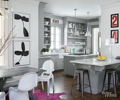 Looking to remodel your kitchen or just give it a style update? Take cues from this beautiful neutral kitchen that sticks to a mostly gray color palette. Add pops of color here and there for visual interest.