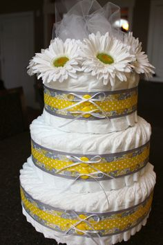 Yellow diaper cake!  Can I make a diaper cake with nipple bows for the gift table ?