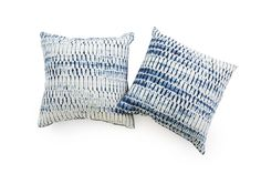 natural indigo shibori pillow by noon design studio $169 Hand dyed with natural indigo made from plants.  Each pillow is finely pleated before dyeing to create a unique and one-of-a-kind shibori* pattern, and  will vary slightly because of the hand-crafted process. Made from 100% organic cotton that was woven in North Carolina, sewn and dyed in downtown Los Angeles. 18 x 18 inches *Shibori is an ancient Japanese technique of folding, stitching and clamping fabric before dyeing to create…